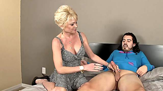 Aroused auntie loves playing with nephew's young dick